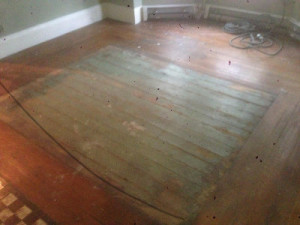 dirty wood floor is ready for wood floor refinishing and sanding in Somerville, MA